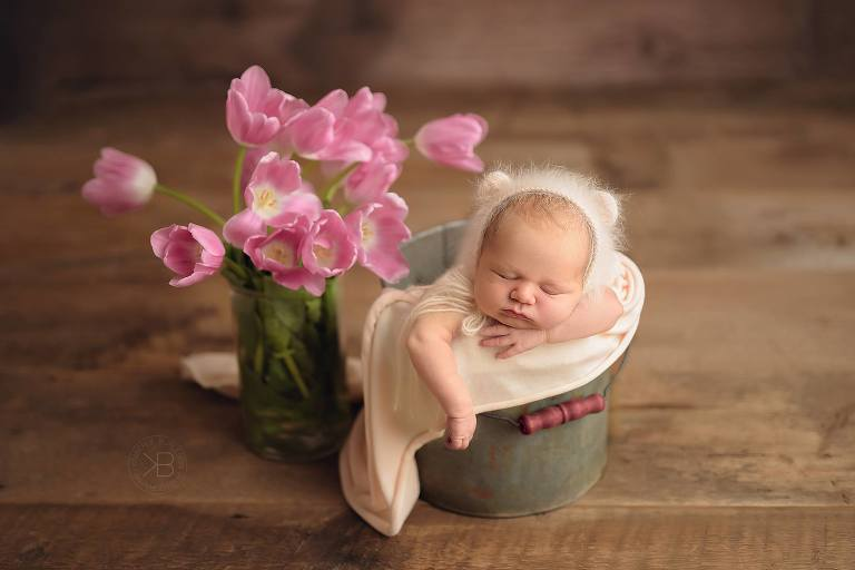 Baby newborn with flower photography